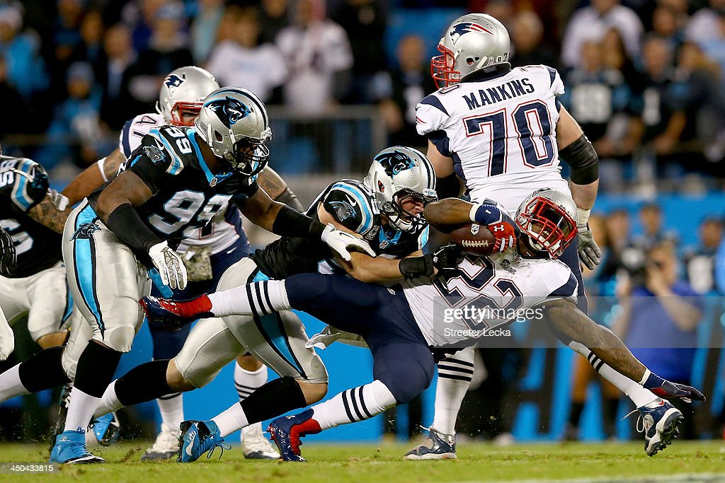 Linebacker Luke Kuechly #59 of the Carolina Panthers tackles running back Stevan Ridley #22 of the New England Patriots in the first half at Bank of America Stadium on November 18, 2013 in Charlotte, North Carolina.