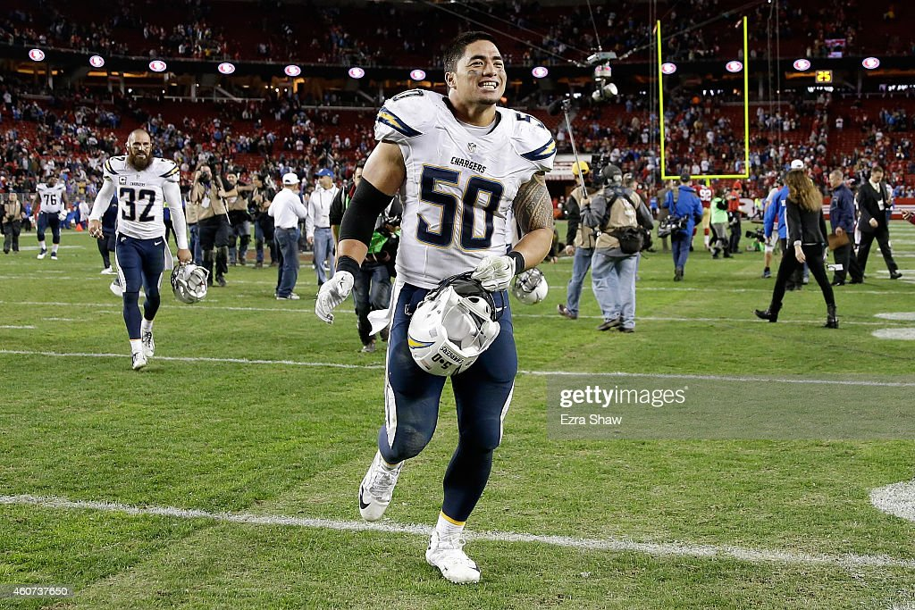 Linebacker <a gi-track='captionPersonalityLinkClicked' href=/galleries/search?phrase=Manti+Te%27o&family=editorial&specificpeople=5654571 ng-click='$event.stopPropagation()'>Manti Te'o</a> #50 of the San Diego Chargers celebrates after the Chargers 38-35 overtime win against the San Francisco 49ers at Levi's Stadium on December 20, 2014 in Santa Clara, California.