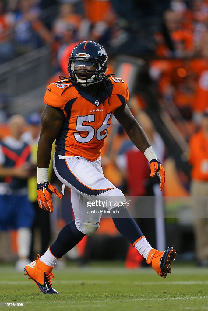 Linebacker <a gi-track='captionPersonalityLinkClicked' href=/galleries/search?phrase=Nate+Irving&family=editorial&specificpeople=4753462 ng-click='$event.stopPropagation()'>Nate Irving</a> #56 of the Denver Broncos celebrates a sack against the Indianapolis Colts at Sports Authority Field at Mile High on September 7, 2014 in Denver, Colorado.