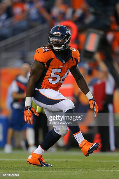 Linebacker Nate Irving of the Denver Broncos celebrates a sack against the Indianapolis Colts at Sports Authority Field at Mile High on September 7...
