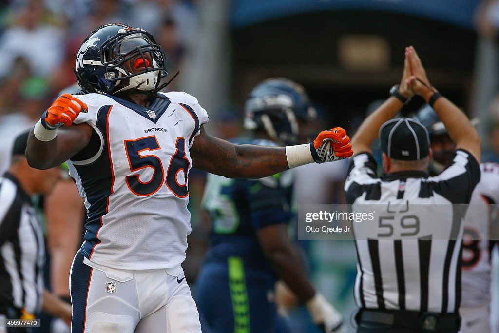 Linebacker <a gi-track='captionPersonalityLinkClicked' href=/galleries/search?phrase=Nate+Irving&family=editorial&specificpeople=4753462 ng-click='$event.stopPropagation()'>Nate Irving</a> #56 of the Denver Broncos celebrates after tackling running back <a gi-track='captionPersonalityLinkClicked' href=/galleries/search?phrase=Marshawn+Lynch&family=editorial&specificpeople=2159904 ng-click='$event.stopPropagation()'>Marshawn Lynch</a> of the Seattle Seahawks in the end zone for a safety in the fourth quarter at CenturyLink Field on September 21, 2014 in Seattle, Washington.
