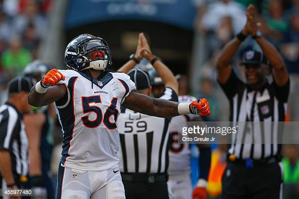 Linebacker Nate Irving of the Denver Broncos celebrates after tackling running back Marshawn Lynch of the Seattle Seahawks in the end zone for a...