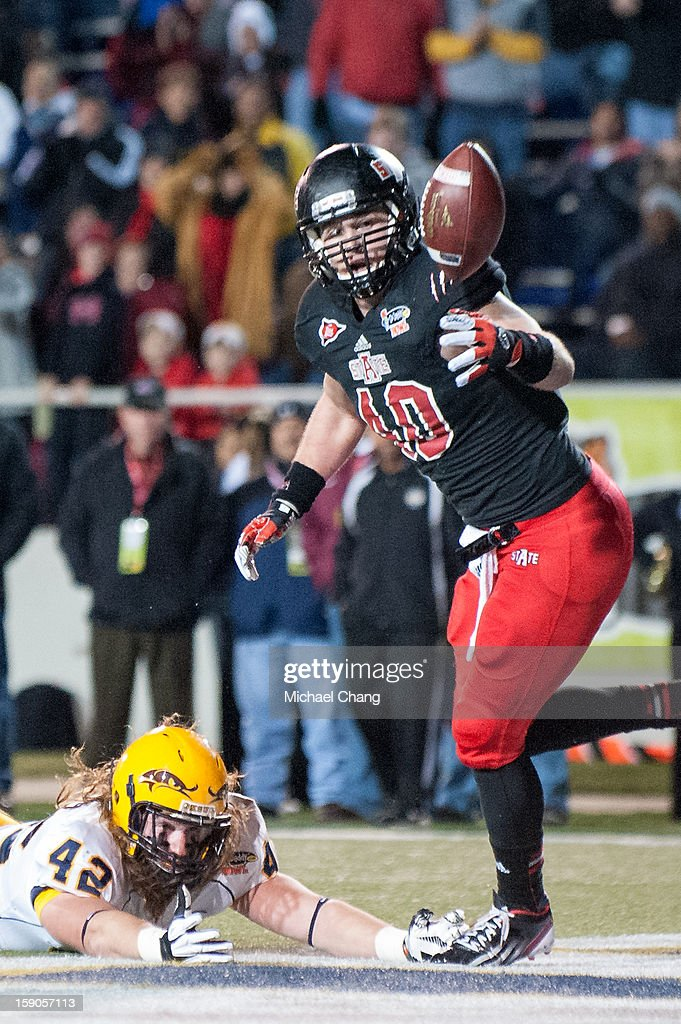 Linebacker Nathan Herrold #40 of the Arkansas State Red Wolves tips and intercepts a pass intended for tightend Tim Erjavec #42 of the Kent State Golden Flashes on January 6, 2013 at Ladd-Peebles Stadium in Mobile, Alabama. Arkansas State defeated Kent State 17-13.