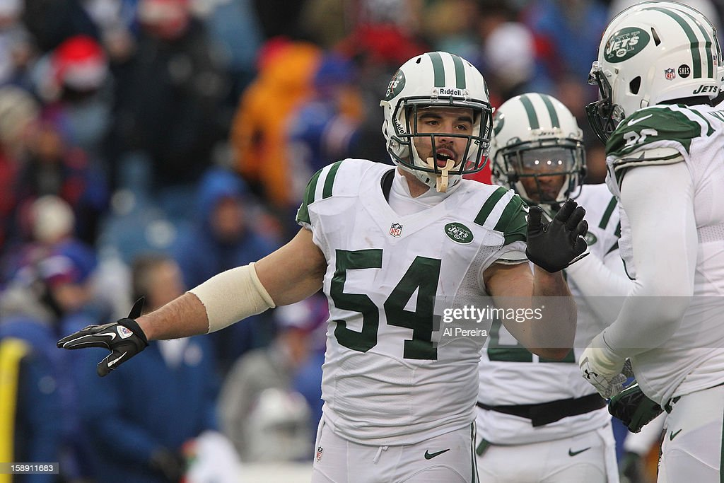 Linebacker Nick Bellore #54 of the New York Jets calls a play against the Buffalo Bills when the Buffalo Bills host the New York Jets at Ralph Wilson Stadium on December 30, 2012 in Orchard Park, New York.
