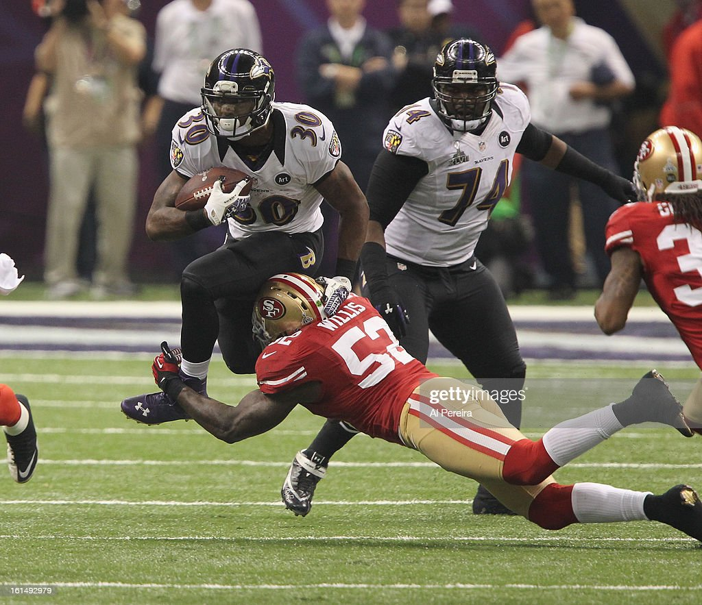 Linebacker Patrick Willis #52 of the San Francisco 49ers stops Running Back Bernard Pierce #30 of the Baltimore Ravens during Super Bowl XLVII at Mercedes-Benz Superdome on February 3, 2013 in New Orleans, Louisiana.