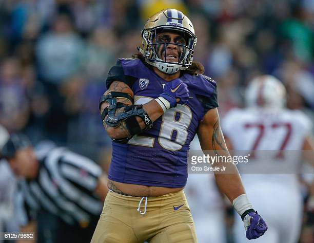 Linebacker Psalm Wooching of the Washington Huskies reacts after sacking quarterback Ryan Burns of the Stanford Cardinal on September 30 2016 at...
