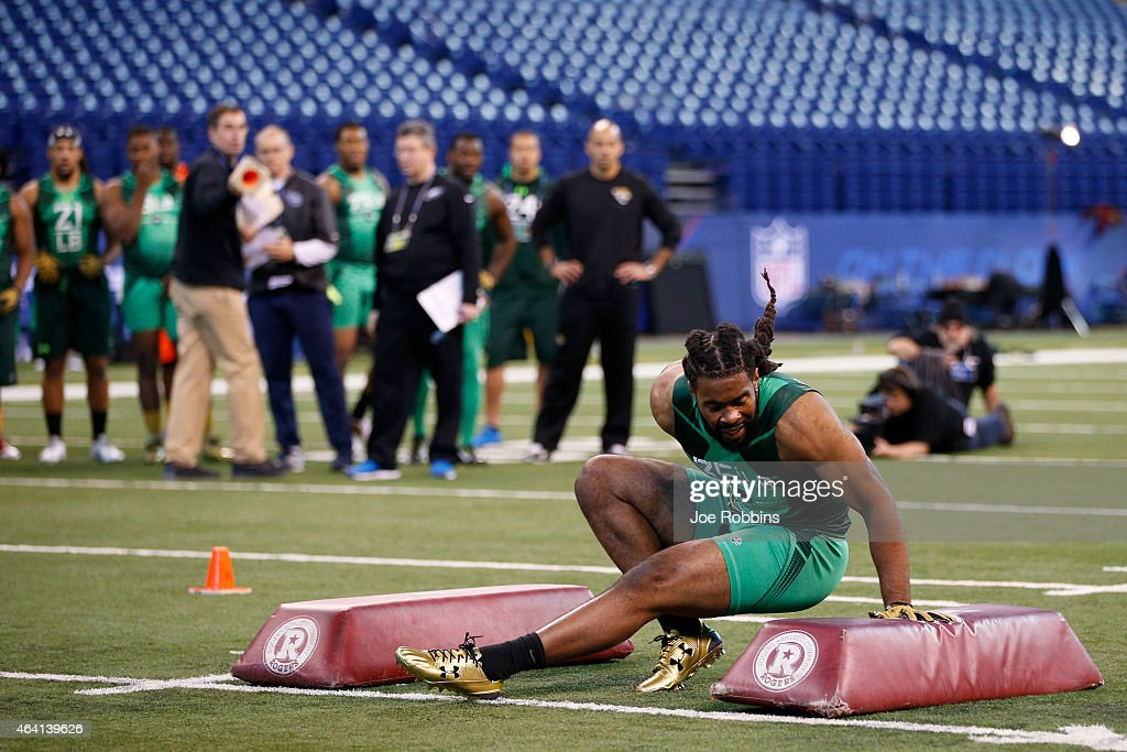 Linebacker Ramik Wilson of Georgia falls while competing in a drill during the 2015 NFL Scouting Combine at Lucas Oil Stadium on February 22 2015 in...