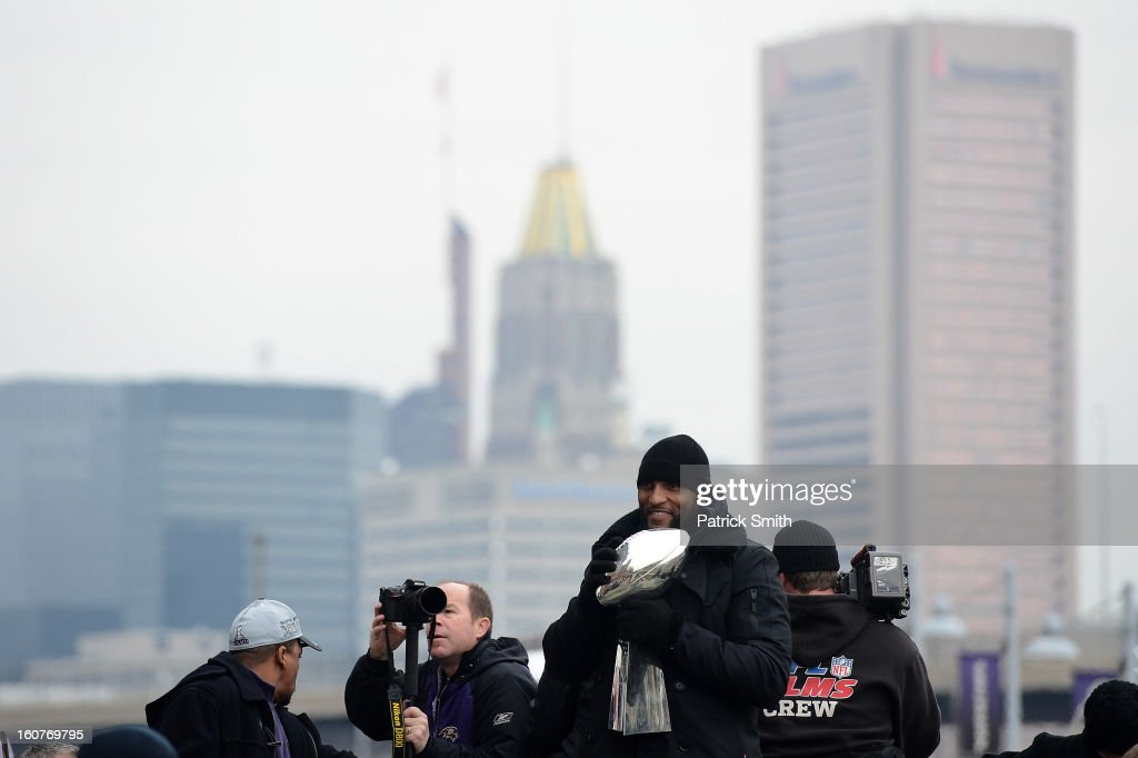 Linebacker Ray Lewis #52 of the Baltimore Ravens celebrates with The Vince Lombardi Trophy as he and teammates celebrate during their Super Bowl XLVII victory parade near M&T Bank Stadium on February 5, 2013 in Baltimore, Maryland. The Baltimore Ravens captured their second Super Bowl title by defeating the San Francisco 49ers.