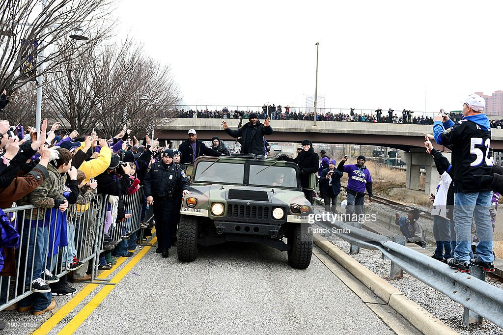 Linebacker Ray Lewis #52 of the Baltimore Ravens waves to fans as he and teammates celebrate during their Super Bowl XLVII victory parade near M&T Bank Stadium on February 5, 2013 in Baltimore, Maryland. The Baltimore Ravens captured their second Super Bowl title by defeating the San Francisco 49ers.
