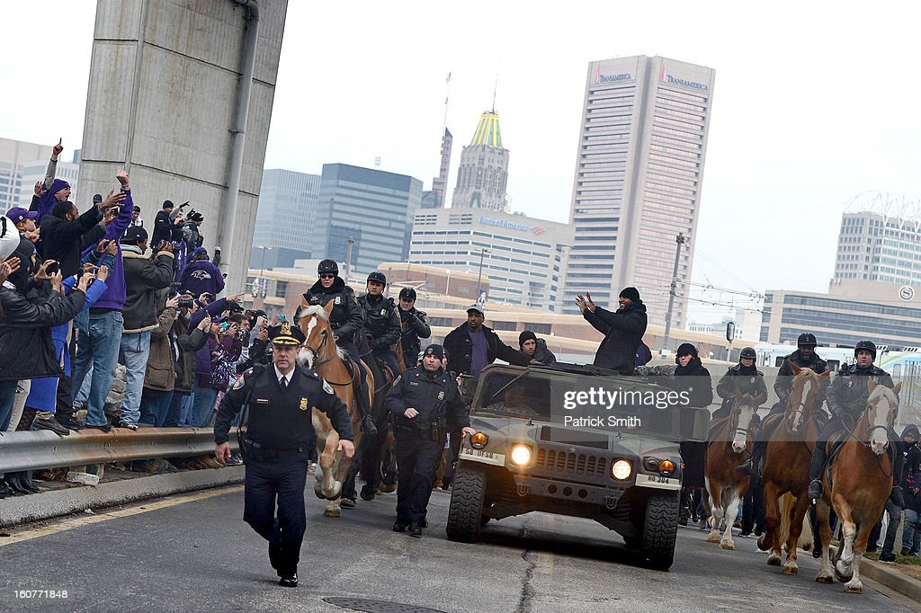 Linebacker <a gi-track='captionPersonalityLinkClicked' href=/galleries/search?phrase=Ray+Lewis&family=editorial&specificpeople=171809 ng-click='$event.stopPropagation()'>Ray Lewis</a> #52 of the Baltimore Ravens waves to fans as he and teammates celebrate during their Super Bowl XLVII victory parade near M&T Bank Stadium on February 5, 2013 in Baltimore, Maryland. The Baltimore Ravens captured their second Super Bowl title by defeating the San Francisco 49ers.