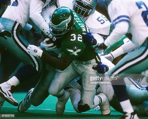 Linebacker Robert Jones of the Dallas Cowboys stops running back Ricky Watters of the Philadelphia Eagles at Texas Stadium in the 1995 NFC Divisional...