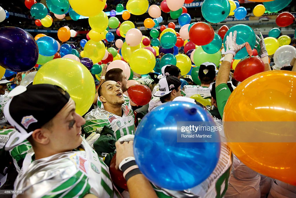 Linebacker Rodney Hardrick of the Oregon Ducks celebrates on the field after defeating the Texas Longhorns 307 in the Valero Alamo Bowl at the...