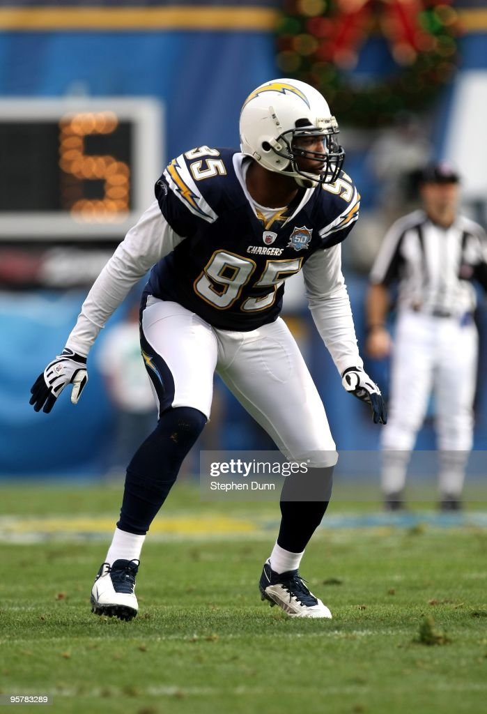 Linebacker Shaun Phillips #95 of the San Diego Chargers sets on the line in the game with the Cincinnati Bengals on December 20, 2009 at Qualcomm Stadium in San Diego, California. The Chargers won 27-24.