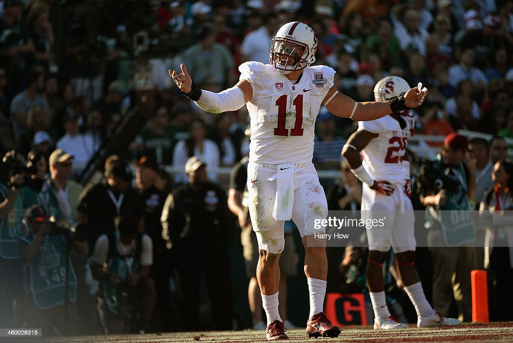 Linebacker <a gi-track='captionPersonalityLinkClicked' href=/galleries/search?phrase=Shayne+Skov&family=editorial&specificpeople=6362886 ng-click='$event.stopPropagation()'>Shayne Skov</a> #11 of the Stanford Cardinal reacts to a pass interference penalty called against him during the 100th Rose Bowl Game presented by Vizio against the Michigan State Spartans at the Rose Bowl on January 1, 2014 in Pasadena, California.