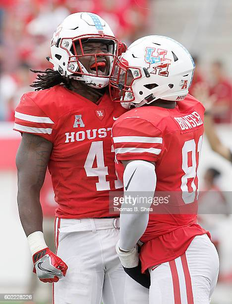 Linebacker Steven Taylor and linebacker Tyus Bowser of the Houston Cougars celebrate sacking the Lamar Cardinals quarterback in the second half at...