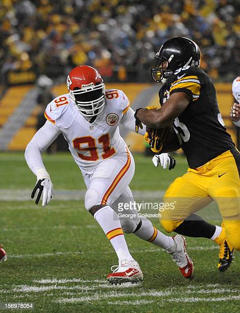 Linebacker Tamba Hali of the Kansas City Chiefs pursues running back Isaac Redman of the Pittsburgh Steelers at Heinz Field on November 12 2012 in...