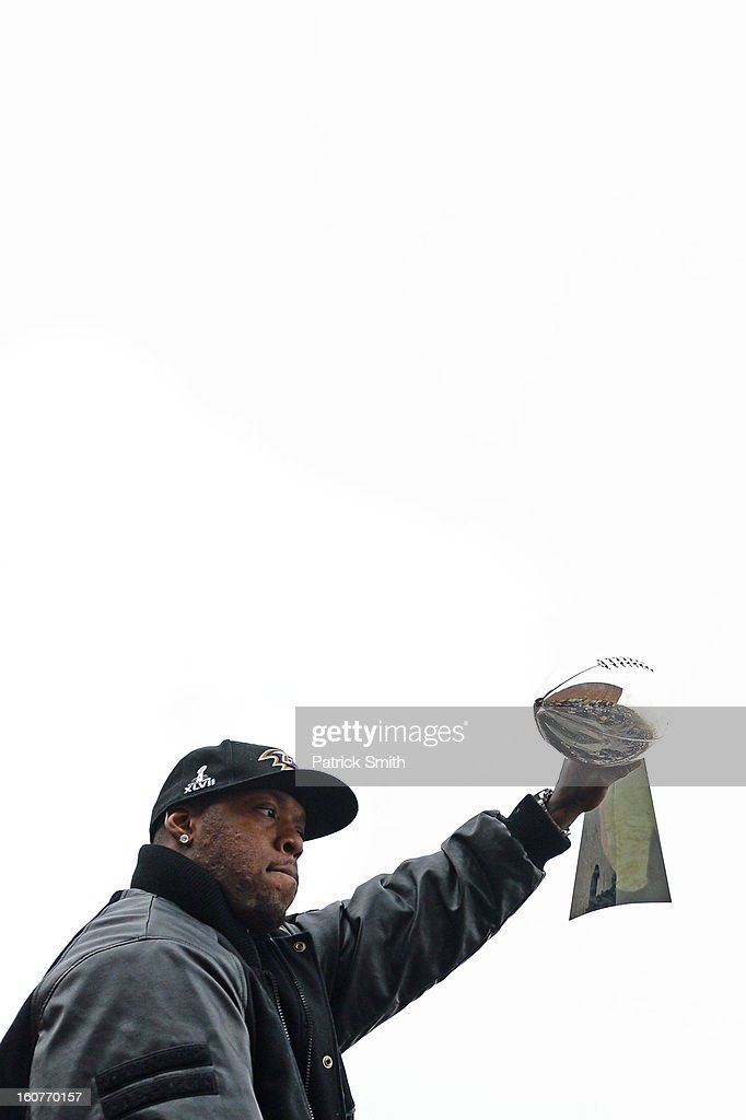 Linebacker Terrell Suggs #55 of the Baltimore Ravens holds The Vince Lombardi Trophy as he and teammates celebrate during their Super Bowl XLVII victory parade near M&T Bank Stadium on February 5, 2013 in Baltimore, Maryland. The Baltimore Ravens captured their second Super Bowl title by defeating the San Francisco 49ers.