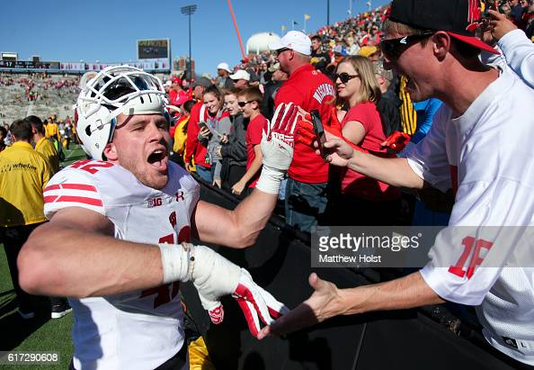 Linebacker TJ Watt of the Wisconsin Badgers celebrates with fans after defeating the Iowa Hawkeyes on October 22 2016 at Kinnick Stadium in Iowa City...