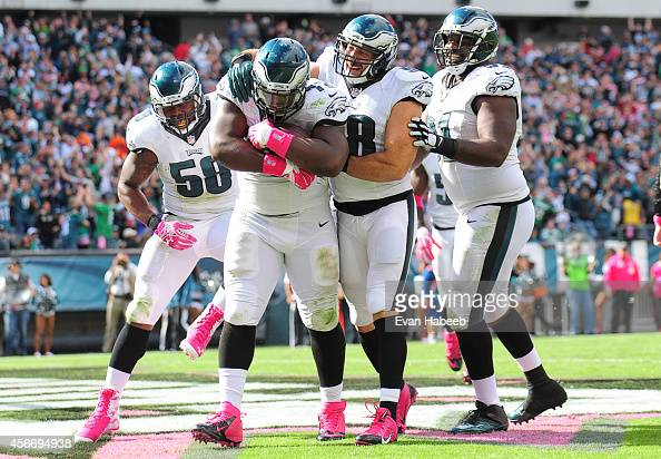 Linebacker Trent Cole defensive end Cedric Thornton linebacker Connor Barwin and defensive end Fletcher Cox react after Thornton recovered a fumble...