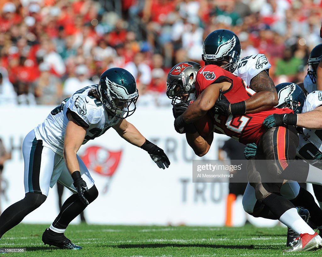 Linebacker Trent Cole #58 of the Philadelphia Eagles tackles running back Dough Martin #22 of the Tampa Bay Buccaneers December 9, 2012 at Raymond James Stadium in Tampa, Florida. The Eagles won 23 - 21.