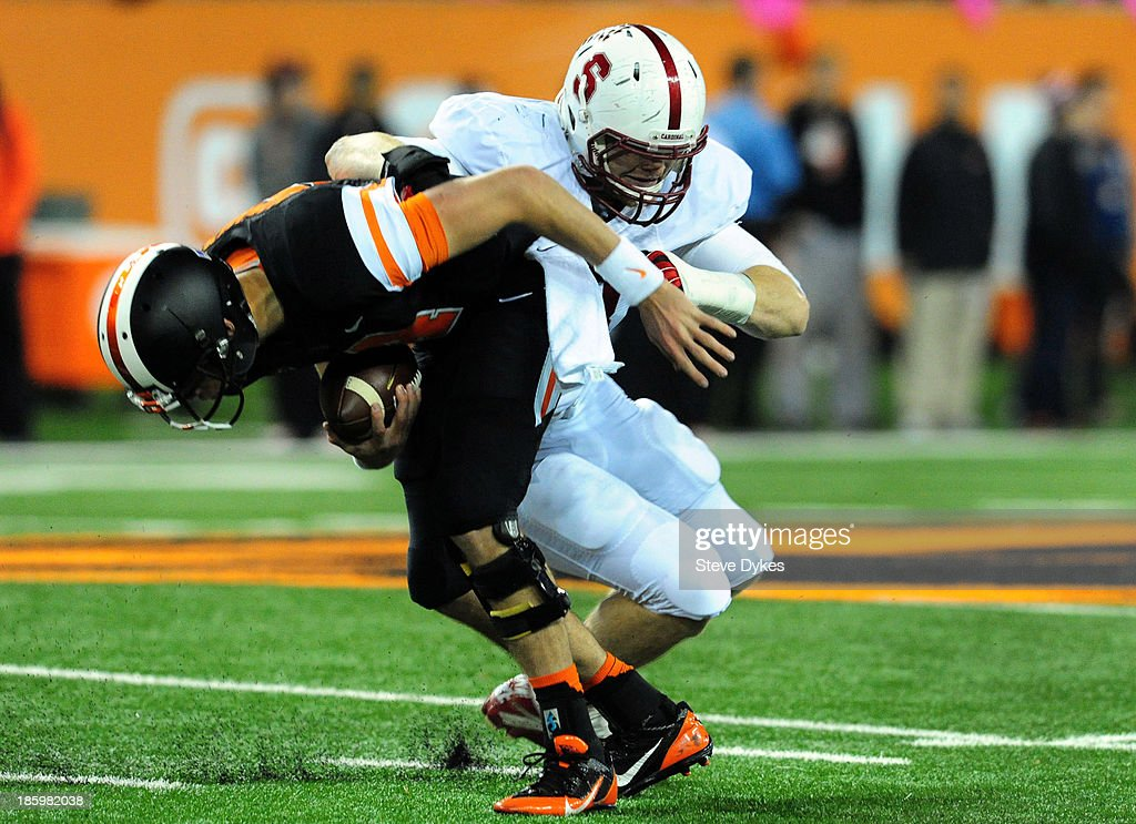 Linebacker Trent Murphy #93 of the Stanford Cardinal sacks quarterback <a gi-track='captionPersonalityLinkClicked' href=/galleries/search?phrase=Sean+Mannion&family=editorial&specificpeople=8221853 ng-click='$event.stopPropagation()'>Sean Mannion</a> #4 of the Oregon State Beavers during the first quarter of the game at Reser Stadium on October 26, 2013 in Corvallis, Oregon.