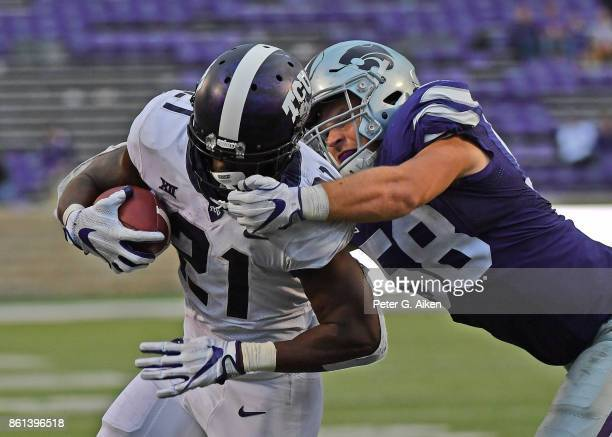Linebacker Trent Tanking of the Kansas State Wildcats grabs the facemask of running back Kyle Hicks of the TCU Horned Frogs during the second half on...