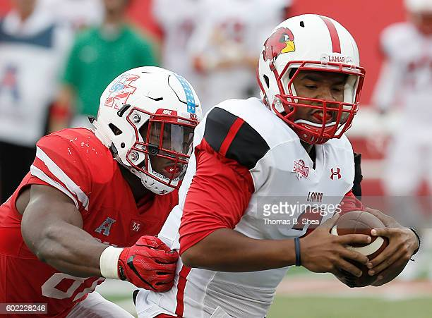 Linebacker Tyus Bowser sacks quarterback Andrew Allen of the Lamar Cardinals of the Houston Cougars in the second half at TDECU Stadium on September...