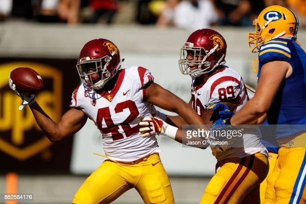 Linebacker Uchenna Nwosu of the USC Trojans celebrates after recovering a fumble during the fourth quarter against the California Golden Bears at...