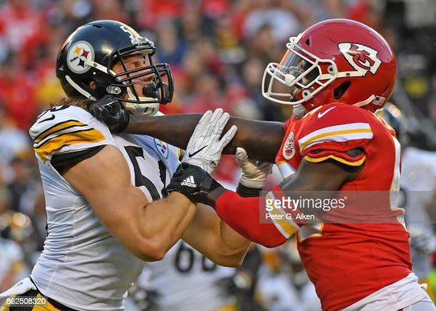 Linebacker Ukeme Eligwe of the Kansas City Chiefs blocks linebacker Anthony Chickillo of the Pittsburgh Steelers during a kickoff in the second half...