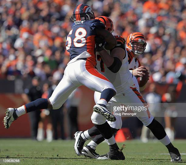 Linebacker Von Miller of the Denver Broncos blocked by offensive tackle Andrew Whitworth of the Cincinnati Bengals as he protects quarterback Andy...