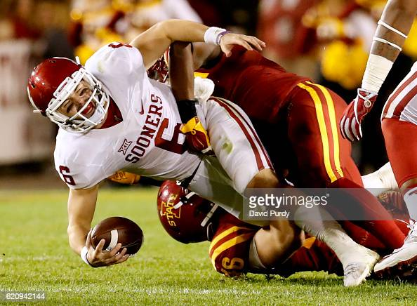 Linebacker Willie Harvey of the Iowa State Cyclones sacks quarterback Baker Mayfield of the Oklahoma Sooners as he scrambled for yards in the second...