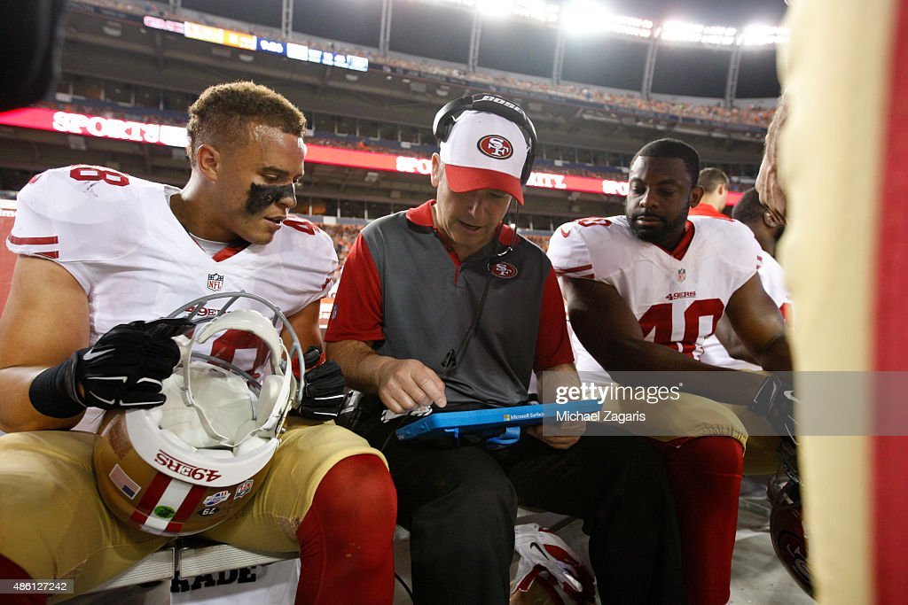 Linebackers Coach Clancy Pendergast of the San Francisco 49ers talks with Shayne Skov #48 and Steve Beauharnais #40 on the sideline during the game against the Denver Broncos at Sports Authority Field on August 29, 2015 in Denver, Colorado. The Broncos defeated the 49ers 19-12.