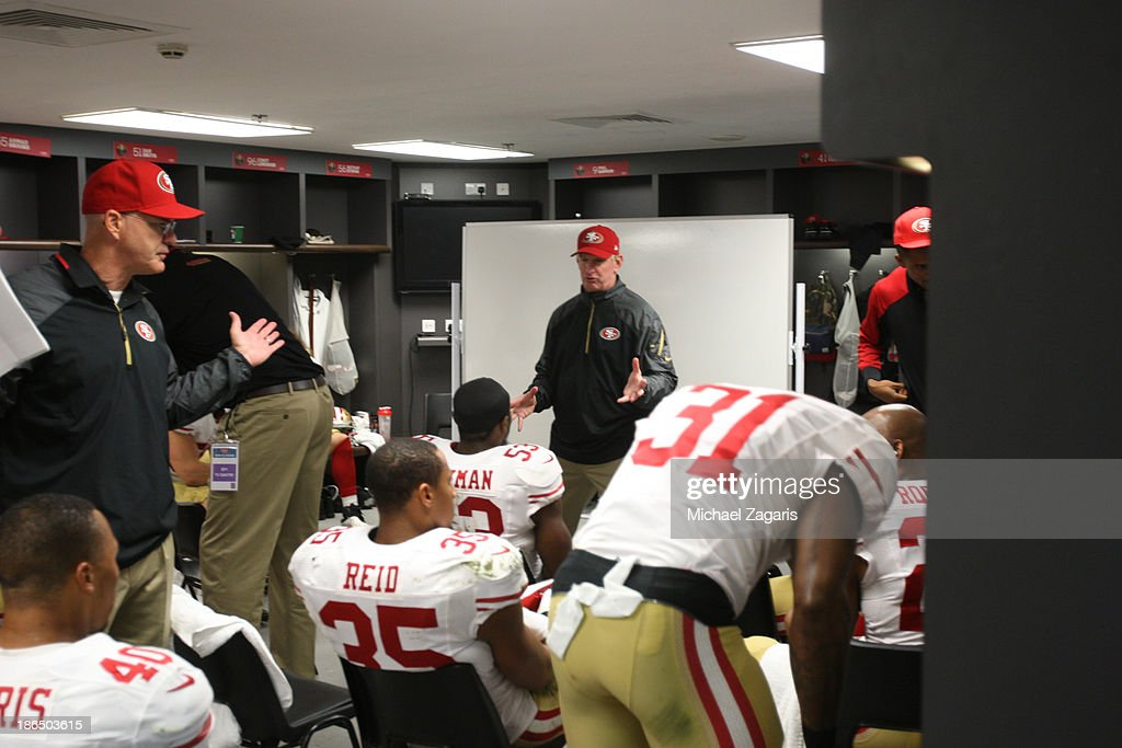 Linebackers Coach Jim Leavitt and Secondary Coach Ed Donatell of the San Francisco 49ers talks wit the team in the locker room during halftime of the...
