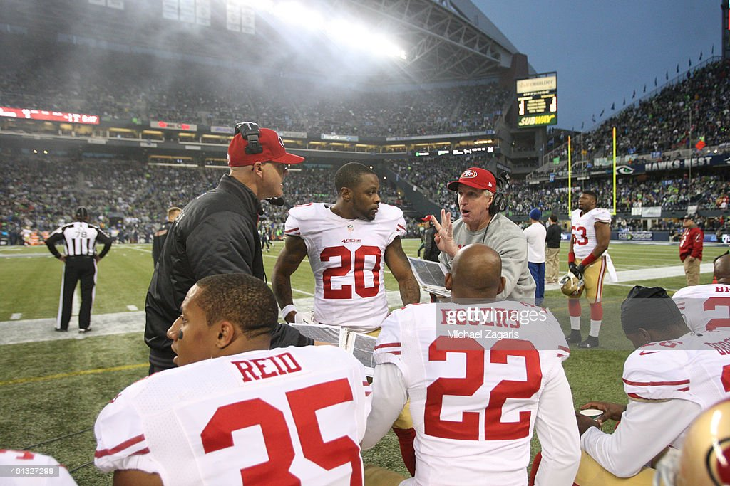 Linebackers Coach Jim Leavitt and Secondary Coach Ed Donatell of the San Francisco 49ers talk with Eric Reid Perrish Cox and Carlos Rogers during the...