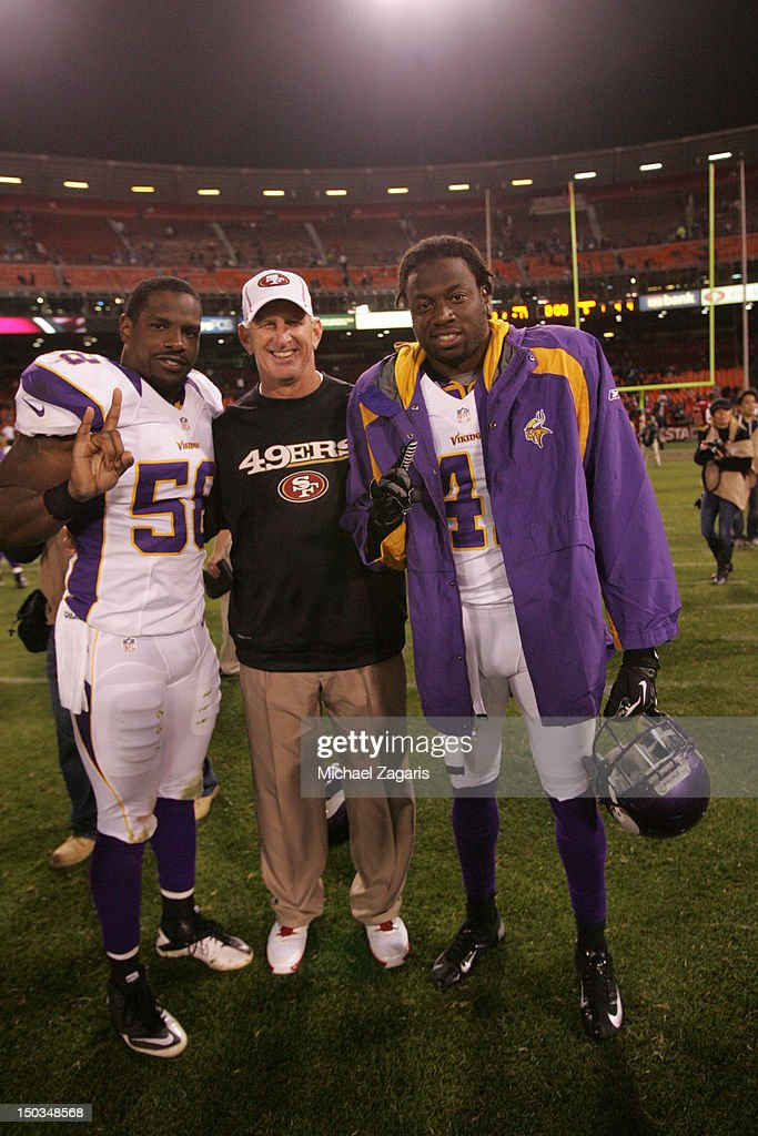 Linebackers Coach Jim Leavitt of the San Francisco 49ers stands with Tyrone McKenzie and Mistral Raymond of the Minnesota Vikings all South Florida...