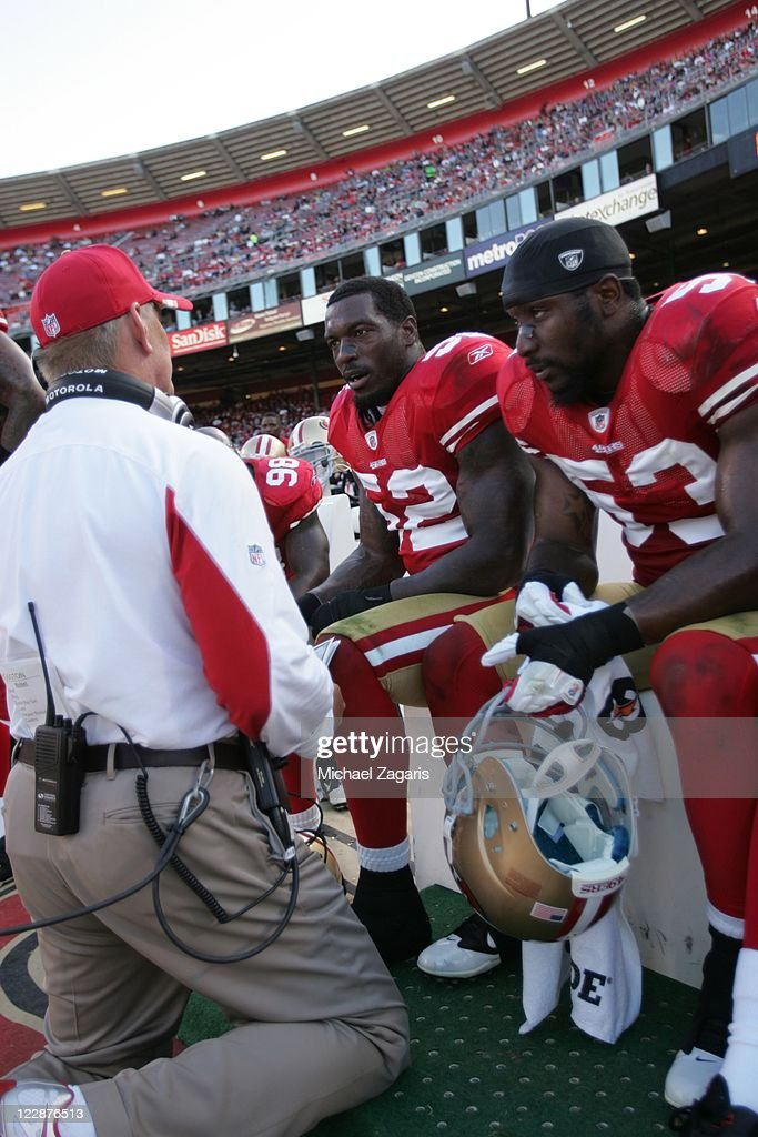 Linebackers Coach Jim Leavitt of the San Francisco 49ers talks to Patrick Willis and NaVorro Bowman during the game against the Houston Texans at...