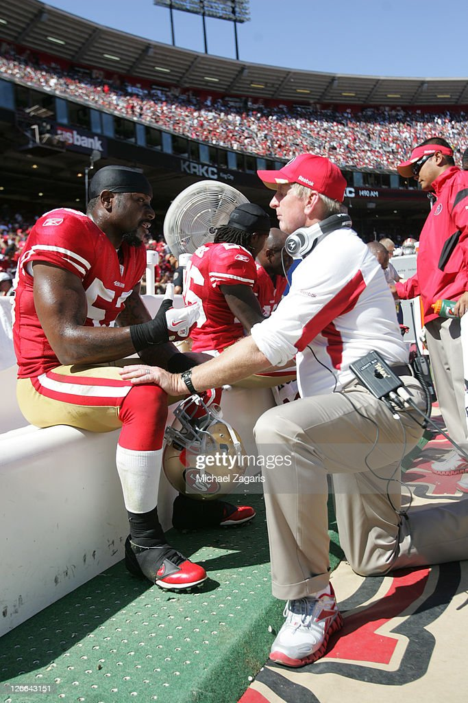 Linebackers Coach Jim Leavitt of the San Francisco 49ers talks with NaVorro Bowman during the game against the Dallas Cowboys at Candlestick Park on...