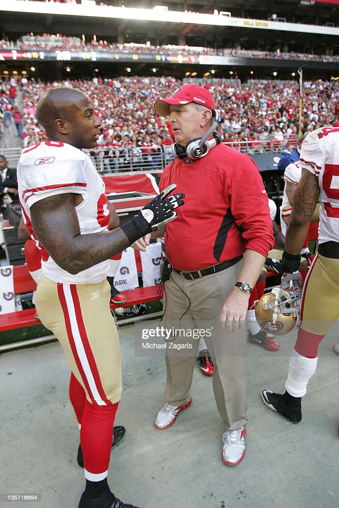 Linebackers Coach Jim Leavitt of the San Francisco 49ers talks with Parys Haralson during the game against the Arizona Cardinals at the University of...