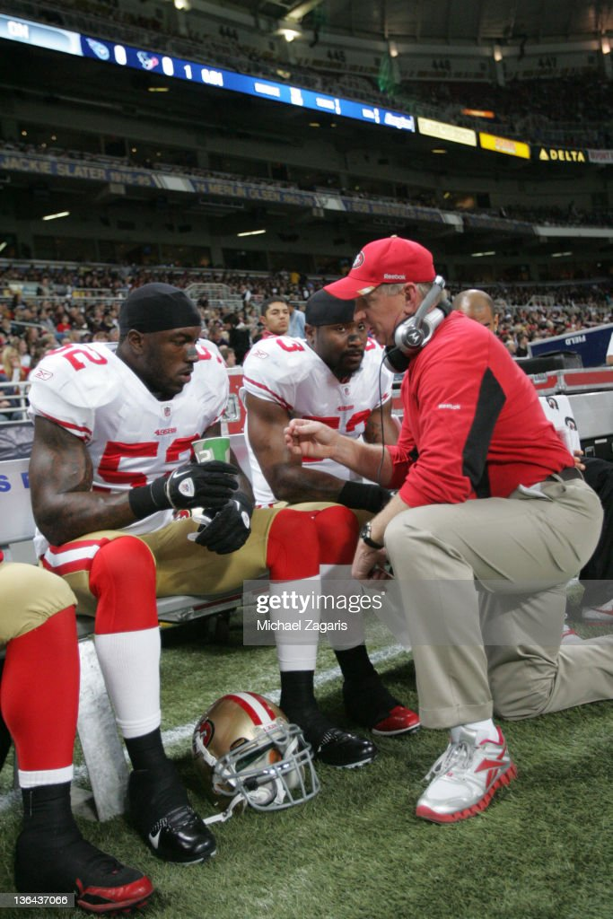 Linebackers Coach Jim Leavitt of the San Francisco 49ers talks with NaVorro Bowman and Patrick Willis during the game against the St Louis Rams at...