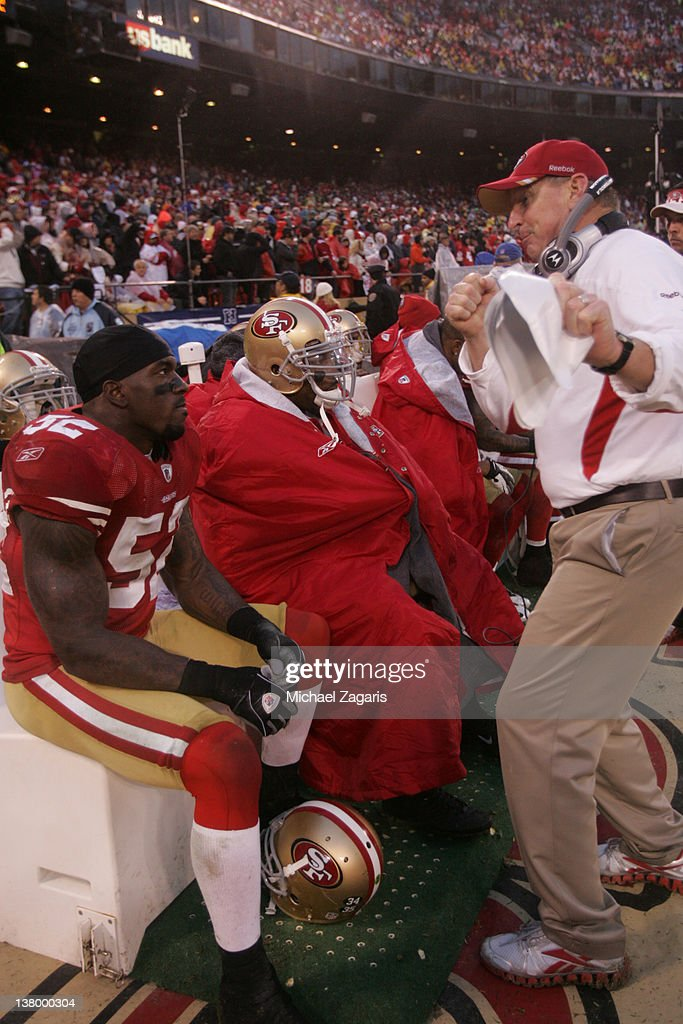 Linebackers Coach Jim Leavitt of the San Francisco 49ers talks with Patrick Willis during the game against the New York Giants at Candlestick Park on...