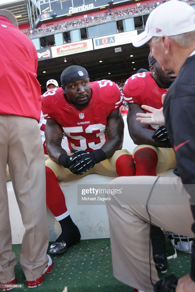 Linebackers Coach Jim Leavitt of the San Francisco 49ers talks with NaVorro Bowman on the sideline during the game against the Minnesota Vikings at...
