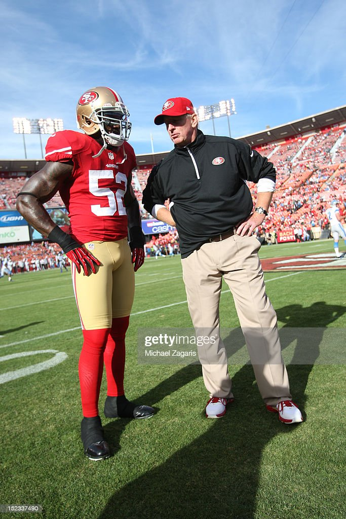 Linebackers Coach Jim Leavitt of the San Francisco 49ers talks with Patrick Willis on the field prior to the game against the Detroit Lions at...