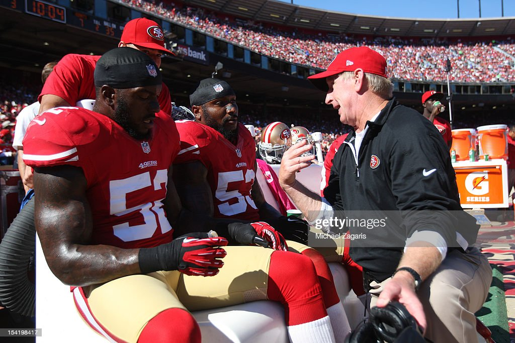 Linebackers Coach Jim Leavitt of the San Francisco 49ers talks with Patrick Willis and NaVorro Bowman during the game against the New York Giants at...