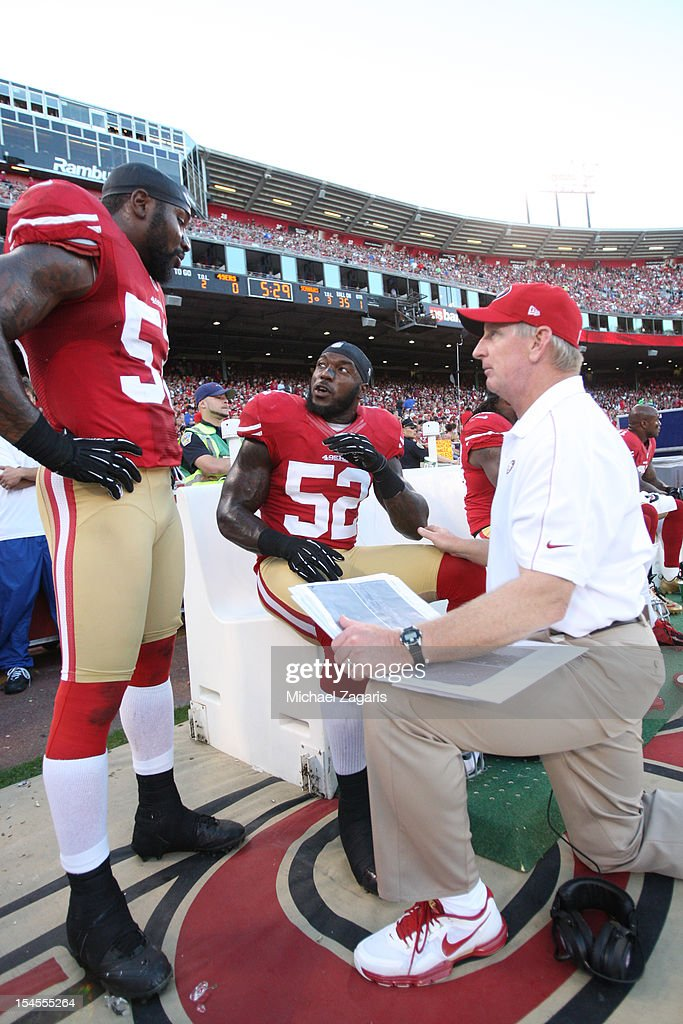Linebackers Coach Jim Leavitt of the San Francisco 49ers talks with NaVorro Bowman and Patrick Willis during the game against the Seattle Seahawks at...