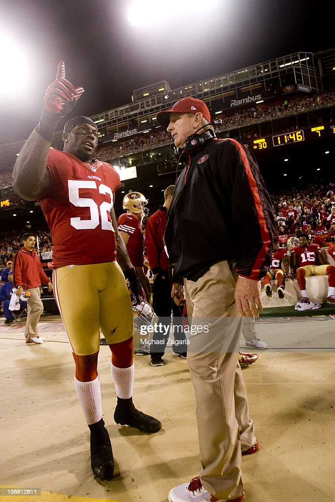 Linebackers Coach Jim Leavitt of the San Francisco 49ers talks with Patrick Willis during the game against the Chicago Bears at Candlestick Park on...