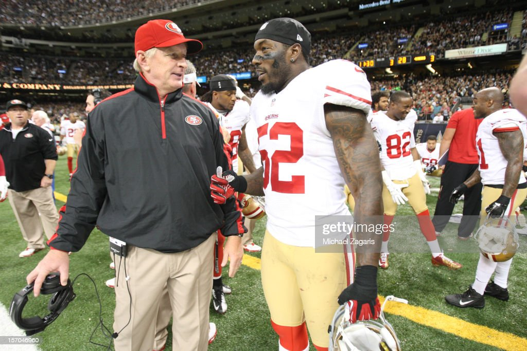 Linebackers Coach Jim Leavitt of the San Francisco 49ers talks with Patrick Willis during the game against the New Orleans Saints at the MercedesBenz...