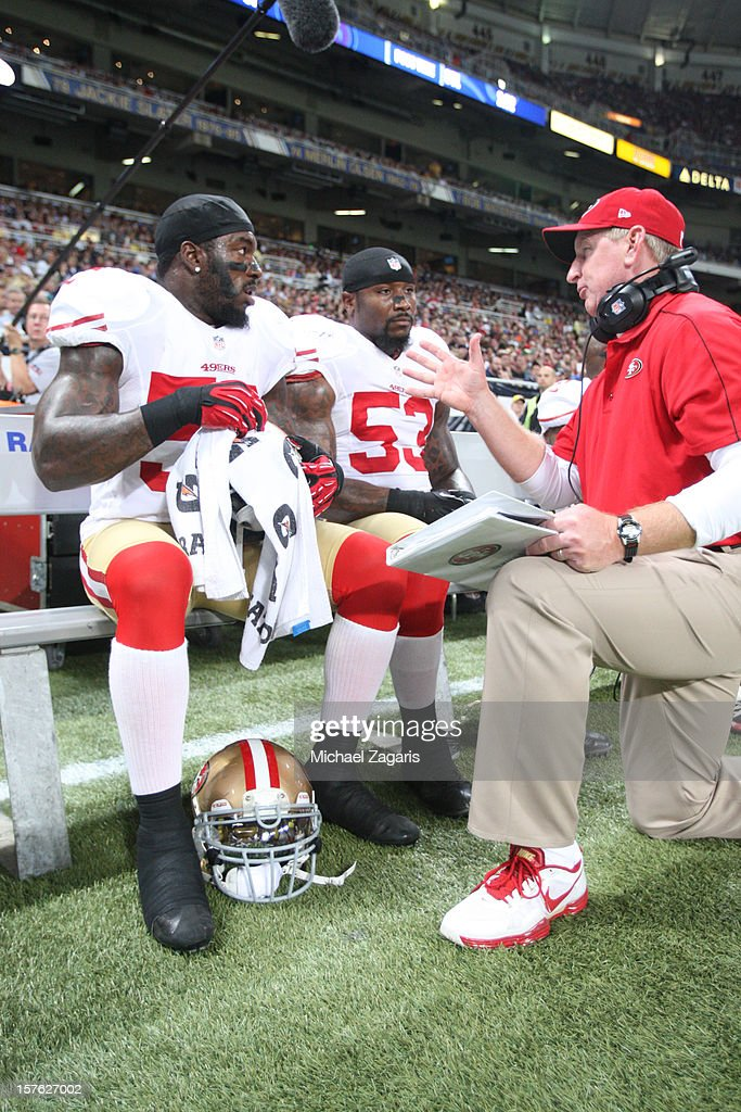 Linebackers Coach Jim Leavitt of the San Francisco 49ers talks with Patrick Willis and NaVorro Bowman during the game against the St Louis Rams at...