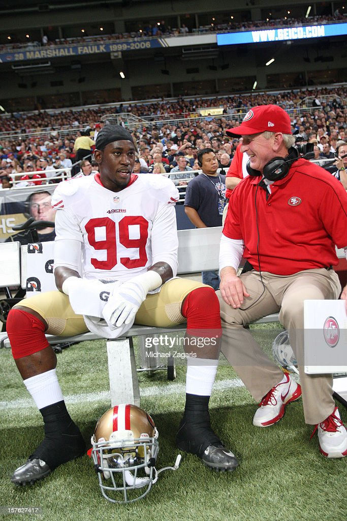 Linebackers Coach Jim Leavitt of the San Francisco 49ers talks with Aldon Smith during the game against the St Louis Rams at the Edward Jones Dome on...