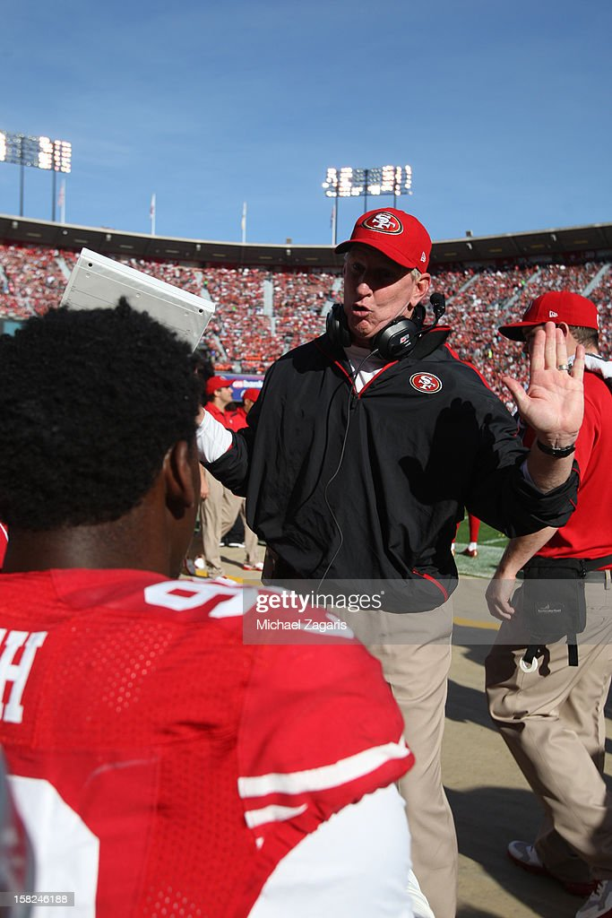 Linebackers Coach Jim Leavitt of the San Francisco 49ers talks with Aldon Smith during the game against the Miami Dolphins at Candlestick Park on...