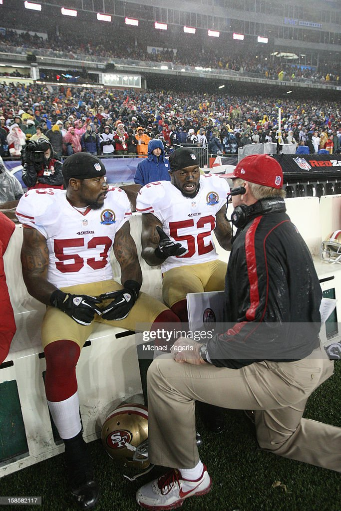 Linebackers Coach Jim Leavitt of the San Francisco 49ers talks with NaVorro Bowman and Patrick Willis during the game against the New England...